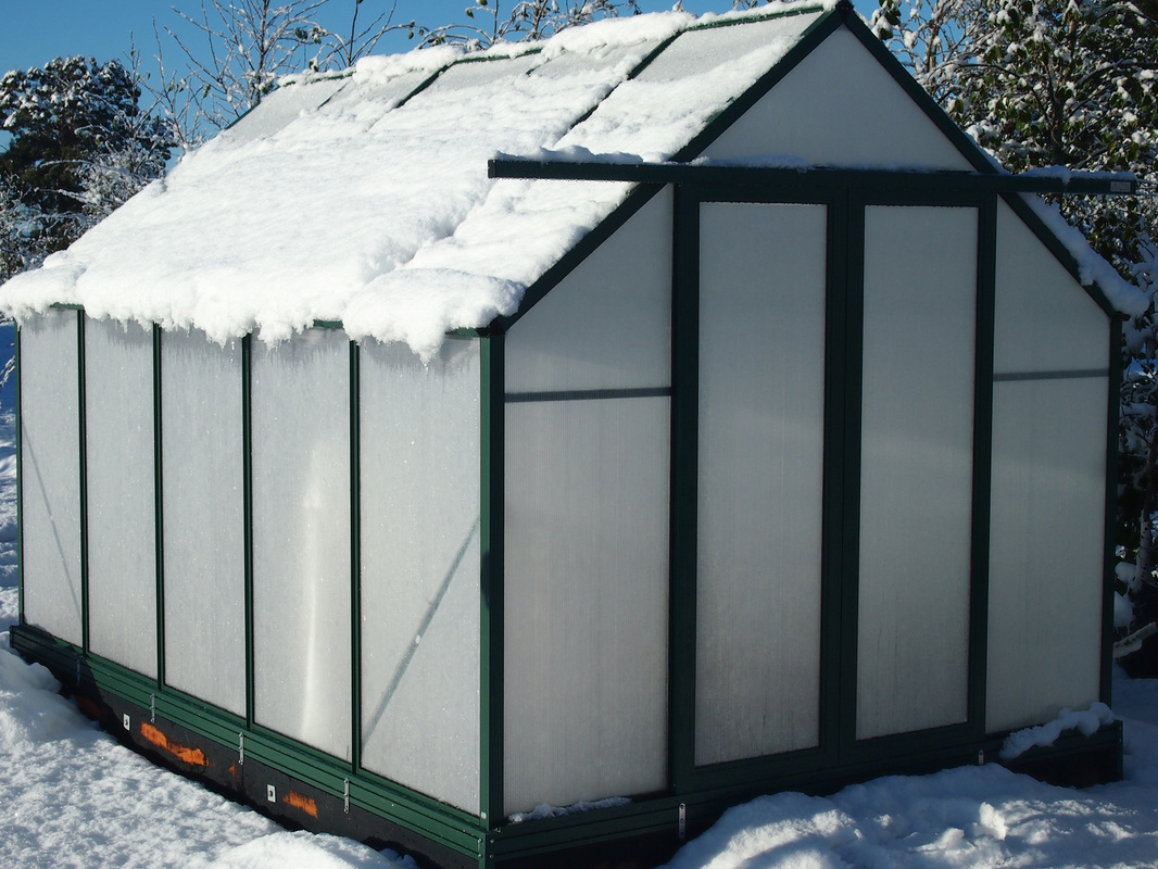 Greenhouse in snow Australia